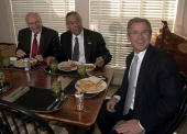 Presidentelect George W Bush shares a working lunch at his ranch with former chairman of the Joint Chiefs of Staff General Colin Powell and US Vice...
