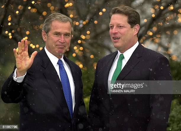 Presidentelect George W Bush waves as he is greeted by Vice president Al Gore at Gore's residence in Washington DC 19 December 2000 Bush who meet...