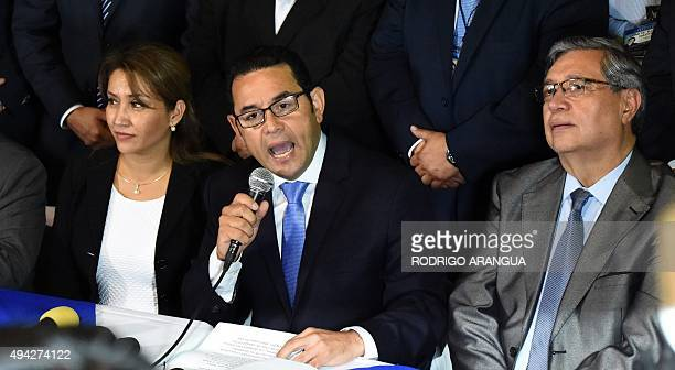 Presidentelect Jimmy Morales of the National Front Convergence delivers a speech next to his wife Hilda Marroquin and his running mate Jafeth Cabrera...