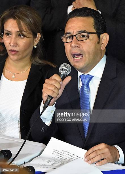 Presidentelect Jimmy Morales of the National Front Convergence delivers a speech next to his wife Gilda Marroquin after winning the runoff election...