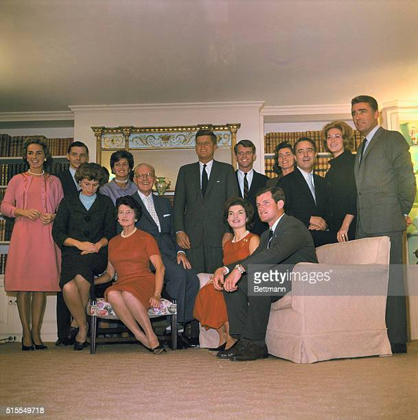 Presidentelect John F Kennedy and members of his family pose in the living room of his father's home here Nov 9th Seated are his sister Mrs R Sargent...