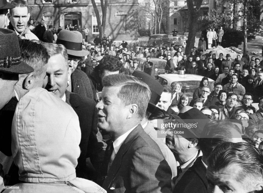 President-elect John F. Kennedy is greeted on the steps of Massachusetts Hall as he arrives at Harvard University for a visit as a member of the board of overseers on Jan. 9, 1961.