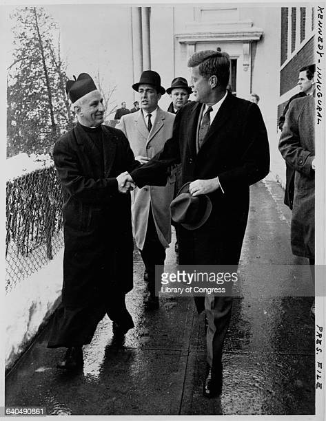 Presidentelect John F Kennedy shakes hands with Father Richard J Casey after attending mass at Holy Trinity Catholic Church prior to inauguration...