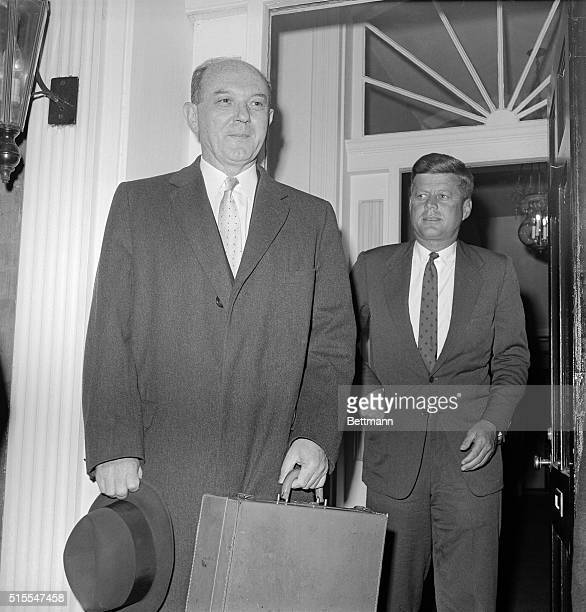 Presidentelect John Kennedy escorts Secretary of State designate Dean Rusk out of his Georgetown house