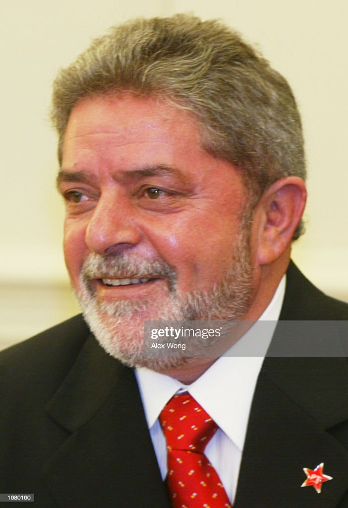 President-elect <a gi-track='captionPersonalityLinkClicked' href=/galleries/search?phrase=Luiz+Inacio+Lula+da+Silva&family=editorial&specificpeople=211609 ng-click='$event.stopPropagation()'>Luiz Inacio Lula da Silva</a> of Brazil smiles during a meeting with U.S. President George W. Bush December 10, 2002 at the Oval Office of the White House in Washington, DC. The two leaders discussed economic security in the region and trads between the U.S. and Brazil.