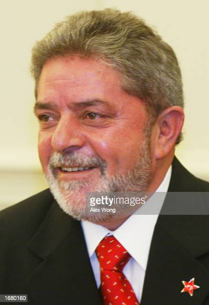 Presidentelect Luiz Inacio Lula da Silva of Brazil smiles during a meeting with US President George W Bush December 10 2002 at the Oval Office of the...