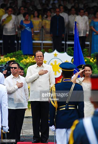 Presidentelect Noynoy Aquino and outgoing President Gloria MacapagalArroyo review Honor Guards during the inauguration of Noynoy Aquino as the...