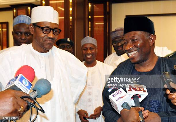 Presidentelect of Nigeria Muhammadu Buhari and Nigerian President Goodluck Jonathan speak to the media after a meeting at the Presidential palace in...