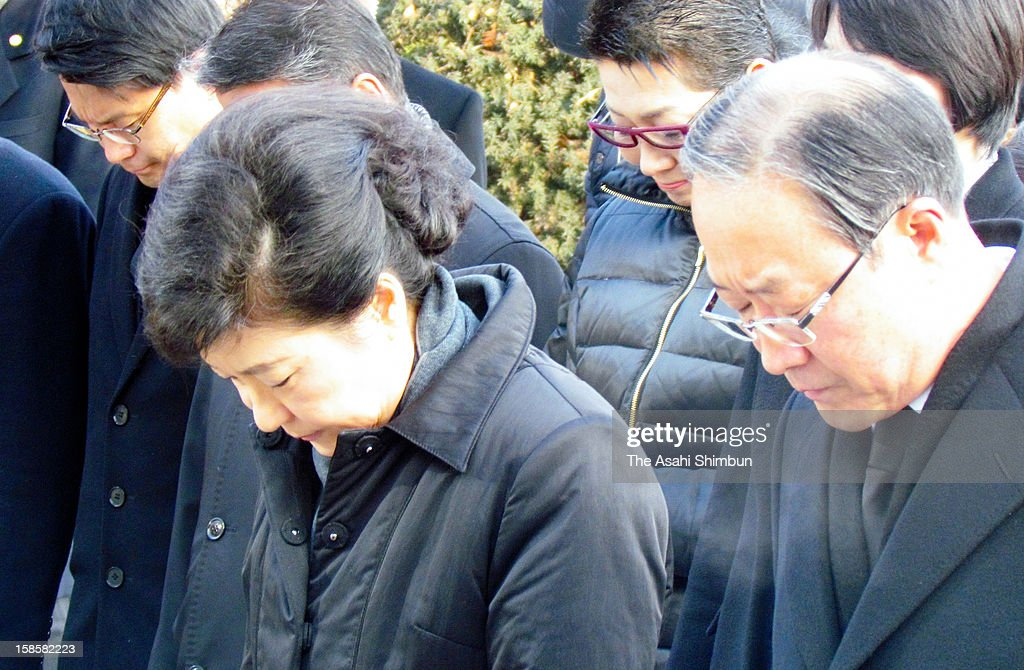 President-elect Park Geun-Hye bows in front of the grave of her father and former President Park Chung-Hee at the National Cemetary on December 20, 2012 in Seoul, South Korea. Park won the presidential election and becomes the first female president of South Korea.