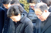 Presidentelect Park GeunHye bows in front of the grave of her father and former President Park ChungHee at the National Cemetary on December 20 2012...
