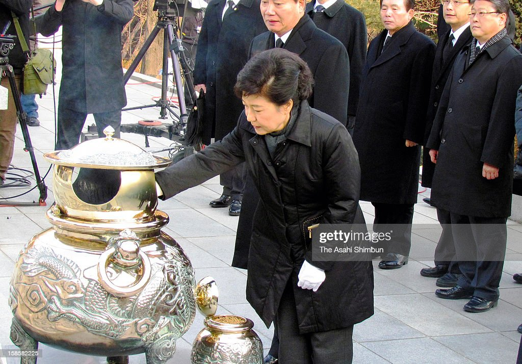 President-elect Park Geun-Hye visits the grave of her father and former President Park Chung-Hee at the National Cemetary on December 20, 2012 in Seoul, South Korea. Park won the presidential election and becomes the first female president of South Korea.