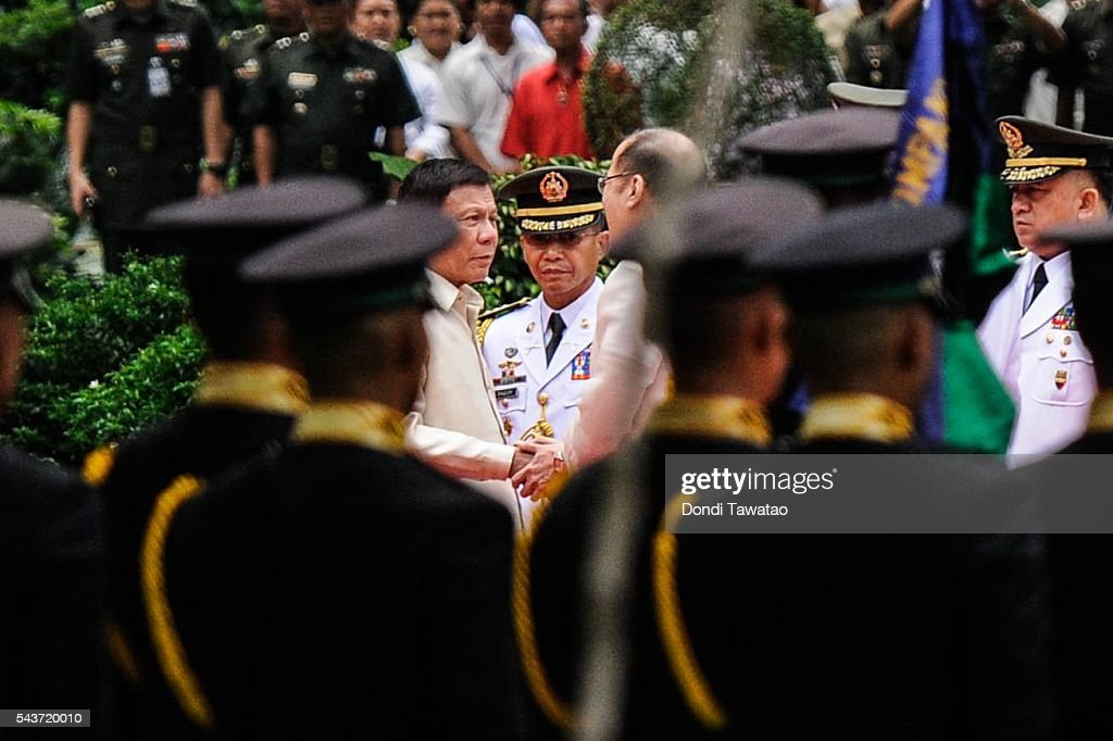 President-elect Rodrigo Roa Duterte and outgoing president <a gi-track='captionPersonalityLinkClicked' href=/galleries/search?phrase=Benigno+Aquino+III&family=editorial&specificpeople=3760869 ng-click='$event.stopPropagation()'>Benigno Aquino III</a> shake hands during the inauguration at Malacanang Palace on June 30, 2016 in Manila, Philippines. <a gi-track='captionPersonalityLinkClicked' href=/galleries/search?phrase=Rodrigo+Duterte&family=editorial&specificpeople=15240619 ng-click='$event.stopPropagation()'>Rodrigo Duterte</a>, a city mayor also known as 'The Punisher', was sworn in as the 16th president of the Philippines on Thursday to serve a six-year term promising to get rid of crime and corruption.