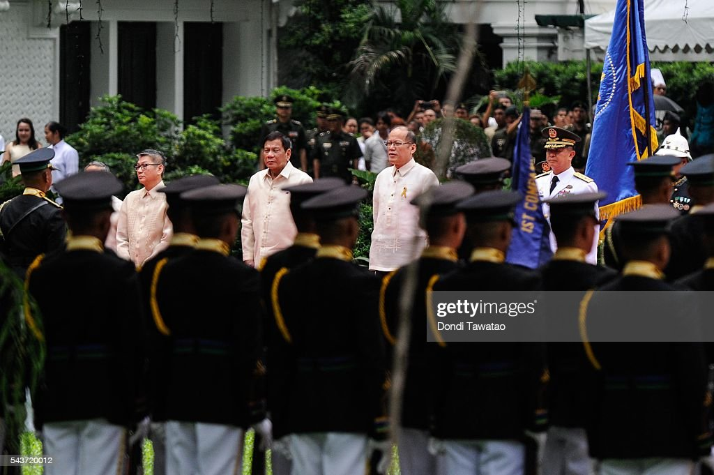 President-elect Rodrigo Roa Duterte and outgoing president <a gi-track='captionPersonalityLinkClicked' href=/galleries/search?phrase=Benigno+Aquino+III&family=editorial&specificpeople=3760869 ng-click='$event.stopPropagation()'>Benigno Aquino III</a> review presidential honor guards during the inauguration at Malacanang Palace on June 30, 2016 in Manila, Philippines. <a gi-track='captionPersonalityLinkClicked' href=/galleries/search?phrase=Rodrigo+Duterte&family=editorial&specificpeople=15240619 ng-click='$event.stopPropagation()'>Rodrigo Duterte</a>, a city mayor also known as 'The Punisher', was sworn in as the 16th president of the Philippines on Thursday to serve a six-year term promising to get rid of crime and corruption.