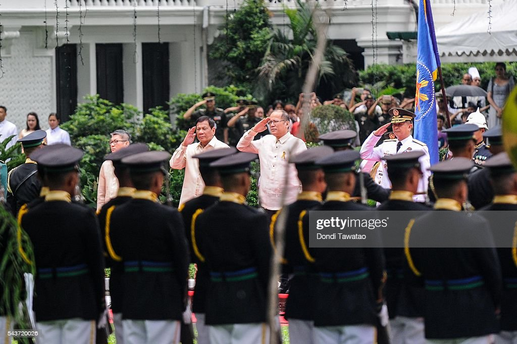 President-elect Rodrigo Roa Duterte and outgoing president <a gi-track='captionPersonalityLinkClicked' href=/galleries/search?phrase=Benigno+Aquino+III&family=editorial&specificpeople=3760869 ng-click='$event.stopPropagation()'>Benigno Aquino III</a> salute presidential honor guards during the inauguration at Malacanang Palace on June 30, 2016 in Manila, Philippines. <a gi-track='captionPersonalityLinkClicked' href=/galleries/search?phrase=Rodrigo+Duterte&family=editorial&specificpeople=15240619 ng-click='$event.stopPropagation()'>Rodrigo Duterte</a>, a city mayor also known as 'The Punisher', was sworn in as the 16th president of the Philippines on Thursday to serve a six-year term promising to get rid of crime and corruption.