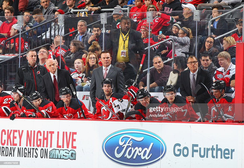 President/GM Lou Lamoriello of the New Jersey Devils and cocoaches Adam Oates and Scott Stevens look on against the Pittsburgh Penguins at the...