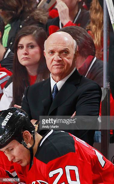 President/GM Lou Lamoriello of the New Jersey Devils looks on against the Montreal Canadiens during the game at the Prudential Center on January 2...