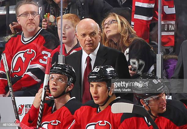 President/GM Lou Lamoriello of the New Jersey Devils looks on against the Pittsburgh Penguins at the Prudential Center on December 29 2014 in Newark...