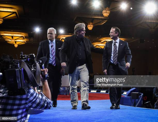 Presidential advisor Steve Bannon center walks offstage with White House Chief of Staff Reince Priebus right after a panel with Matt Schlapp left at...
