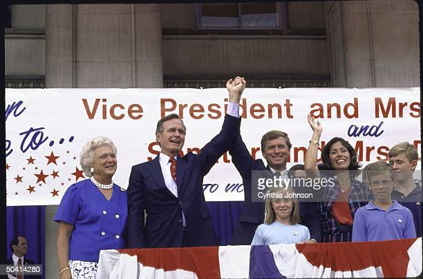 GOP Presidential cadidate George H W Bush and his wife standing with GOP Vice Presidential candidate J Danforth Quayle and his wife at a campaign...