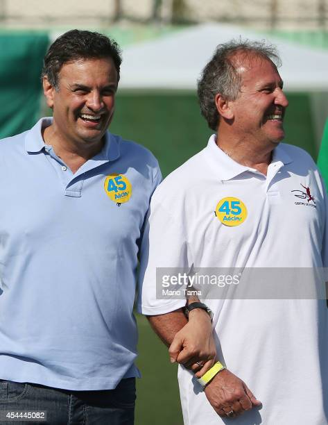 Presidential candidate Aecio Neves of the Brazilian Social Democracy Party walks with Zico at a campaign soccer match at the Zico Football Center on...