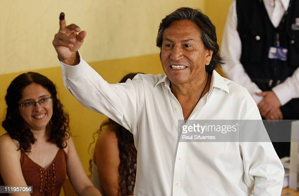 Presidential candidate Alejandro Toledo of the party 'Peru Posible' casts his vote during the general election for presidency for congress and for...