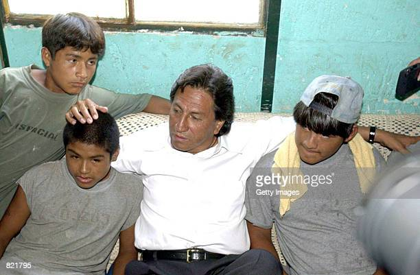 Presidential candidate Alejandro Toledo speaks with homelss children during a visit to a hospice April 3 2001 in Lima Peru The presidential elections...