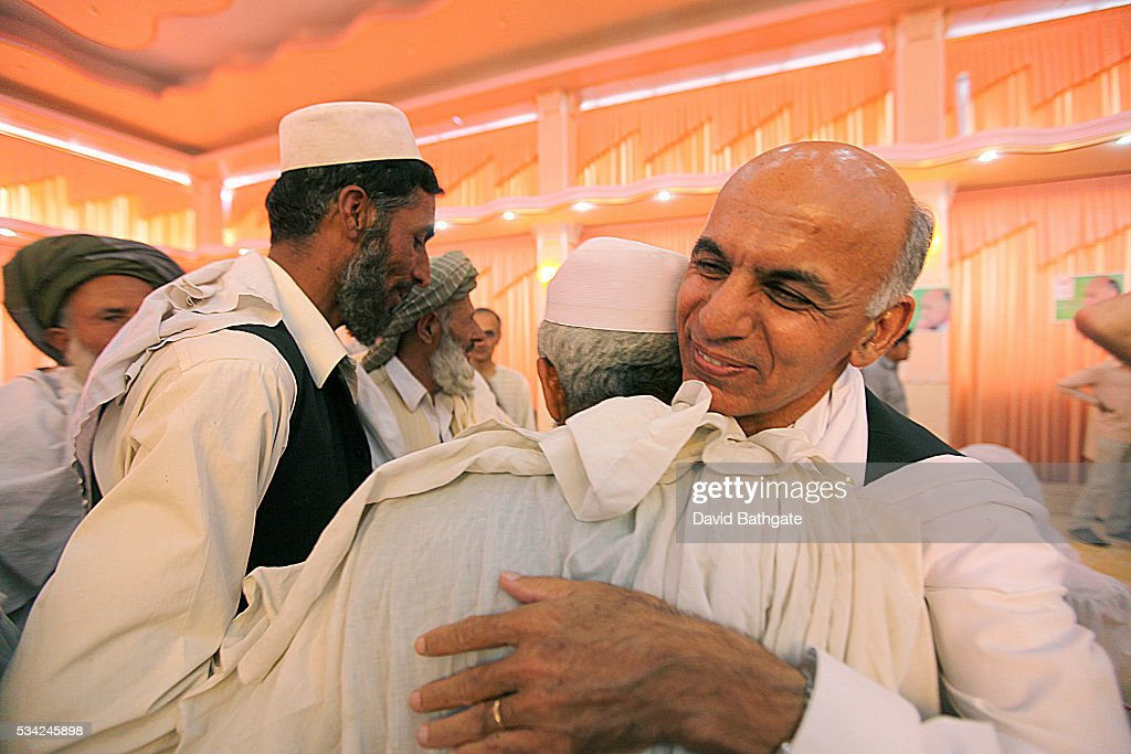 Presidential candidate and former Afghan Finance Minister Ashraf Ghani greets friends and supporters during a campaign engagement in Kabul