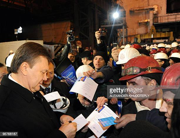 Presidential candidate and head of Regions party Viktor Yanukovich signs autographs during a campaign rally in a metallurgy plant in the Ukrainian...
