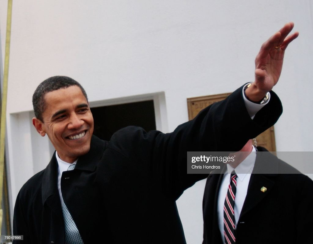 Presidential candidate Barack Obama waves to the outdoor crowd after a rally at Clemson University on January 25, 2008 in Clemson, South Carolina. Obama is keeping a furious schedule of rallies and meetings ahead of the South Carolina primary tommorrow.