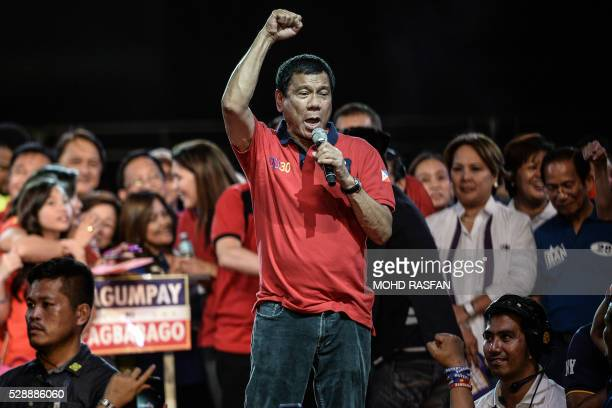 Presidential candidate Davao Mayor Rodrigo Duterte speaks to supporters during an election campaign rally ahead of the presidential and vice...