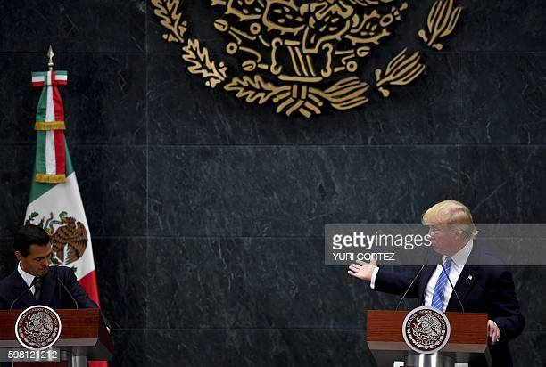 US presidential candidate Donald Trump delivers a joint press conference with Mexican President Enrique Pena Nieto in Mexico City on August 31 2016...