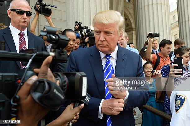 US presidential candidate Donald Trump exits New York Supreme Court after morning jury duty August 17 2015 in New York Trump reported for jury duty...