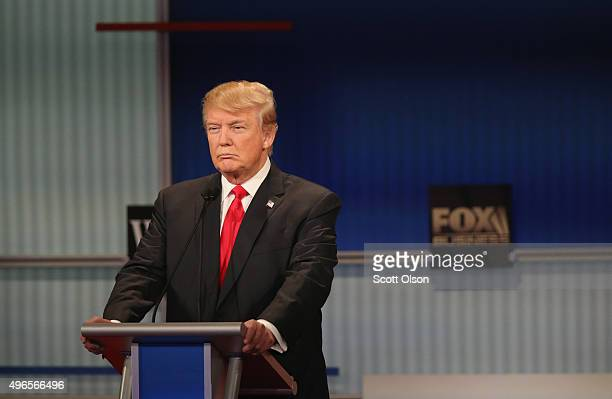 Presidential candidate Donald Trump pauses during the Republican Presidential Debate sponsored by Fox Business and the Wall Street Journal at the...