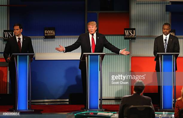 Presidential candidate Donald Trump speaks while Sen Marco Rubio and Ben Carson look on during the Republican Presidential Debate sponsored by Fox...