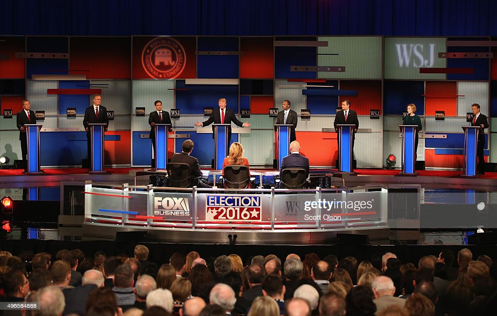 Presidential candidate Donald Trump (4th L) speaks with Ohio Governor John Kasich (L-R), Jeb Bush, Sen. Marco Rubio (R-FL), Ben Carson, Ted Cruz (R-TX), Carly Fiorina, and Sen. Rand Paul (R-KY) take part in the Republican Presidential Debate sponsored by Fox Business and the Wall Street Journal at the Milwaukee Theatre November 10, 2015 in Milwaukee, Wisconsin. The fourth Republican debate is held in two parts, one main debate for the top eight candidates, and another for four other candidates lower in the current polls.