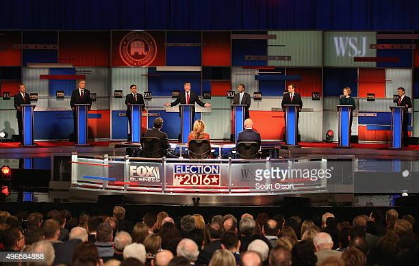 Presidential candidate Donald Trump speaks with Ohio Governor John Kasich Jeb Bush Sen Marco Rubio Ben Carson Ted Cruz Carly Fiorina and Sen Rand...