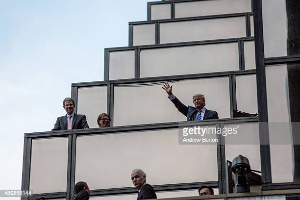 Presidential candidate Donald Trump waves to the crowds waiting for Pope Francis to arrive on 5th Avenue on September 24 2015 in New York City The...