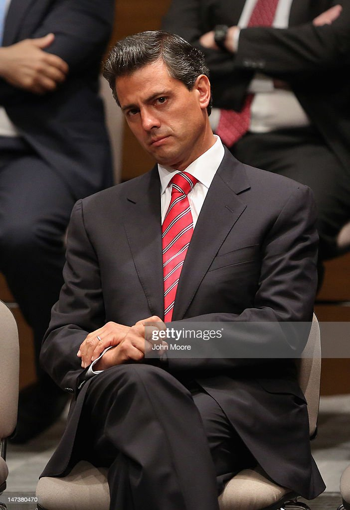 Presidential candidate Enrique Pena Nieto of the Institutional Revolutionary Party (PRI), sits during an event at the country's Federal Election Commission on June 28, 2012 in Mexico City, Mexico. Mexico's four presidential candidates met to sign an agreement to respect each other and the election results, as Mexicans prepare to go to the polls this Sunday, July 1. Pena Nieto is leading in the polls ahead of the vote.