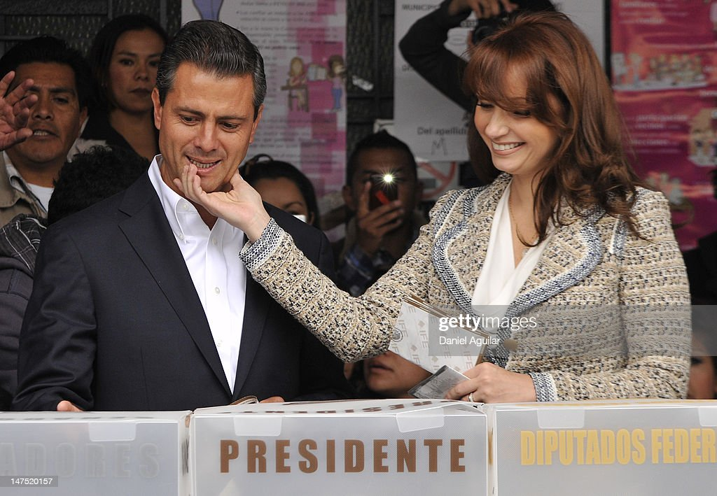 Presidential candidate <a gi-track='captionPersonalityLinkClicked' href=/galleries/search?phrase=Enrique+Pena+Nieto&family=editorial&specificpeople=5957985 ng-click='$event.stopPropagation()'>Enrique Pena Nieto</a> of the Institutional Revolutionary Party (PRI), casts his vote with his wife Angelica Rivero de Pena on July 1, 2012 in Atlacomulco, Mexico. Mexicans went to the polls to choose a new president and vote in thousands of state and local posts nationwide.