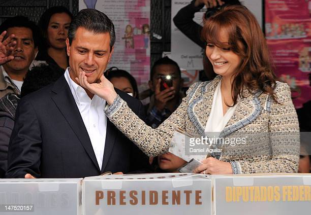 Presidential candidate Enrique Pena Nieto of the Institutional Revolutionary Party casts his vote with his wife Angelica Rivero de Pena on July 1...
