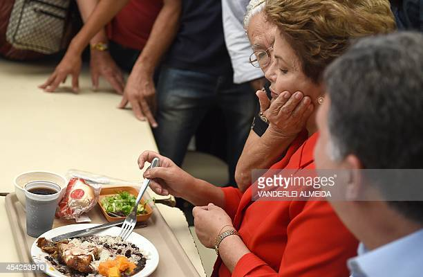 Presidential candidate for the Brazilian Workers' Party and current Brazilian President Dilma Rousseff is greeted by a supporter whilst having lunch...