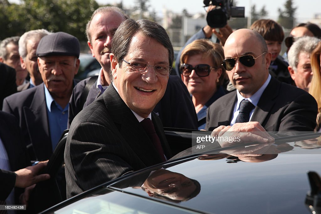 Presidential candidate for the Democratic Rally of Cyprus (DISY) party, Nicos Anastasiades leaves the polling station after voting in the second round of Cyprus' presidential election on February 24, 2013 in Limassol. Cypriots began voting in a crucial left-right presidential runoff to elect a new leader to seal a much needed rescue package for the EU state on the brink of financial ruin.