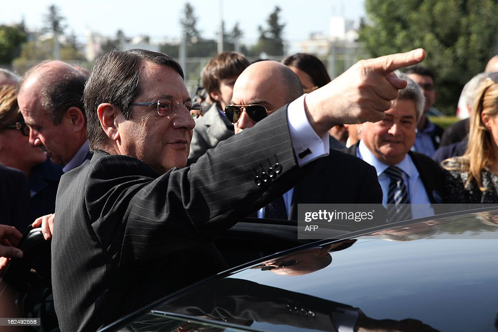Presidential candidate for the Democratic Rally of Cyprus (DISY) party, Nicos Anastasiades stabbs his finger in the air as he leaves the polling station after voting in the second round of Cyprus' presidential election on February 24, 2013 in Limassol. Cypriots began voting in a crucial left-right presidential runoff to elect a new leader to seal a much needed rescue package for the EU state on the brink of financial ruin. AFP PHOTO YIANNIS KOURTOGLOU