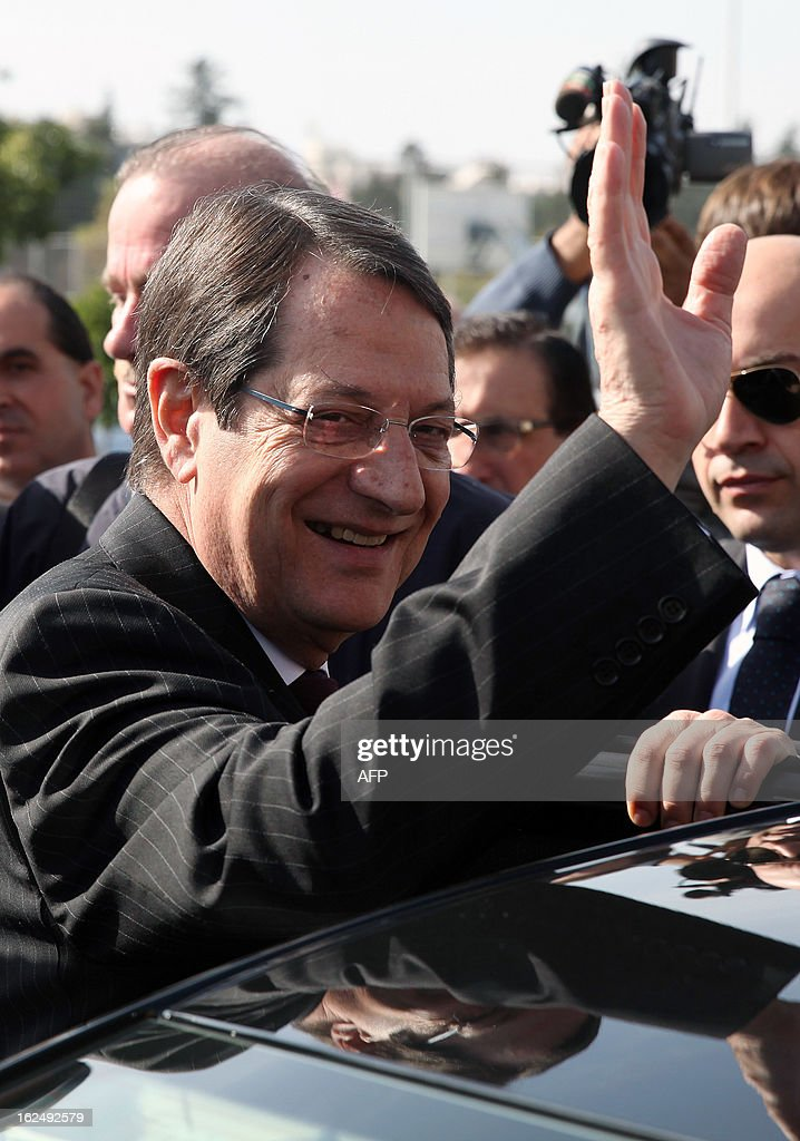 Presidential candidate for the Democratic Rally of Cyprus (DISY) party, Nicos Anastasiades waves as he leaves the polling station after voting in the second round of Cyprus' presidential election on February 24, 2013 in Limassol. Cypriots began voting in a crucial left-right presidential runoff to elect a new leader to seal a much needed rescue package for the EU state on the brink of financial ruin. AFP PHOTO YIANNIS KOURTOGLOU