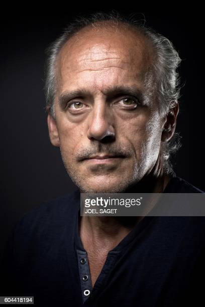 Presidential candidate for the New Anticapitalist Party Philippe Poutou poses for a photo session in Paris on September 5 2016 / AFP PHOTO / JOEL...