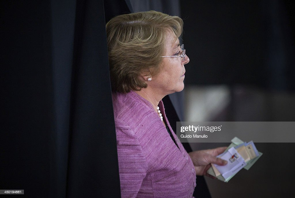 Presidential candidate for the New Majority coalition <a gi-track='captionPersonalityLinkClicked' href=/galleries/search?phrase=Michelle+Bachelet&family=editorial&specificpeople=547978 ng-click='$event.stopPropagation()'>Michelle Bachelet</a> casts her vote at the polls on November 17, 2013 in Santiago, Chile. Around 9 million of Chileans are registered to vote.