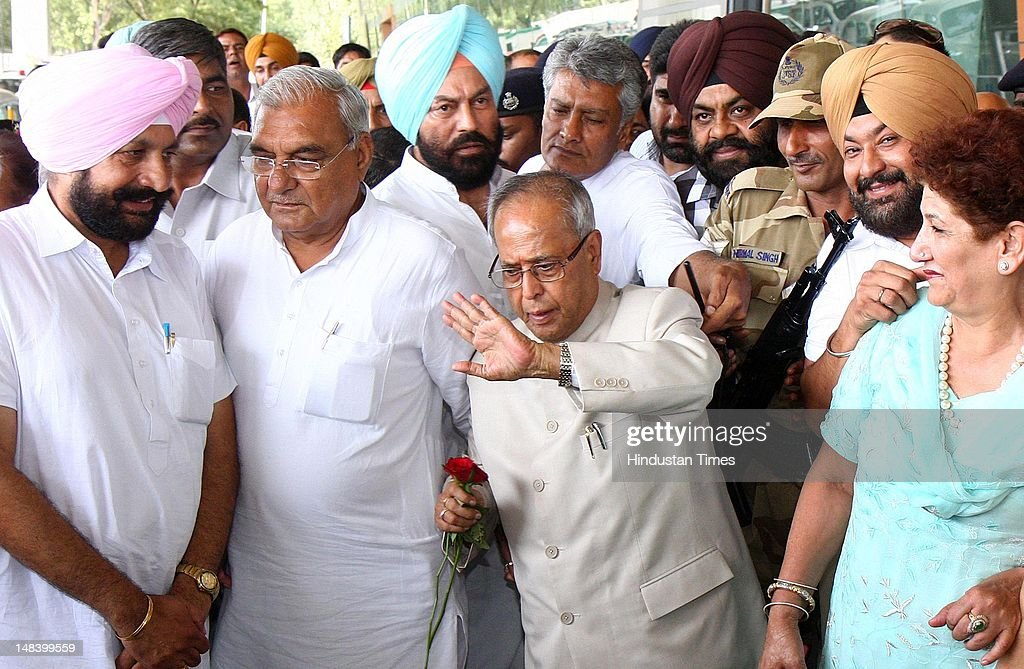 Presidential candidate from Congress party Pranab Mukherjee, Haryana CM Bhupinder Singh Hooda and Sunil Jakhar at Chandigarh Airport on July 15, 2012 in Chandigarh, India.