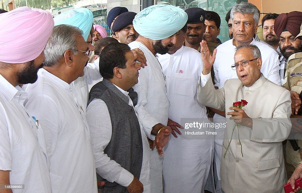 Presidential candidate from Congress party Pranab Mukherjee, Rajeev Shukla Rajya Sabha MP, Haryana CM, Bhupinder Singh Hooda and Sunil Jakhar at Chandigarh Airport on July 15, 2012 in Chandigarh, India.