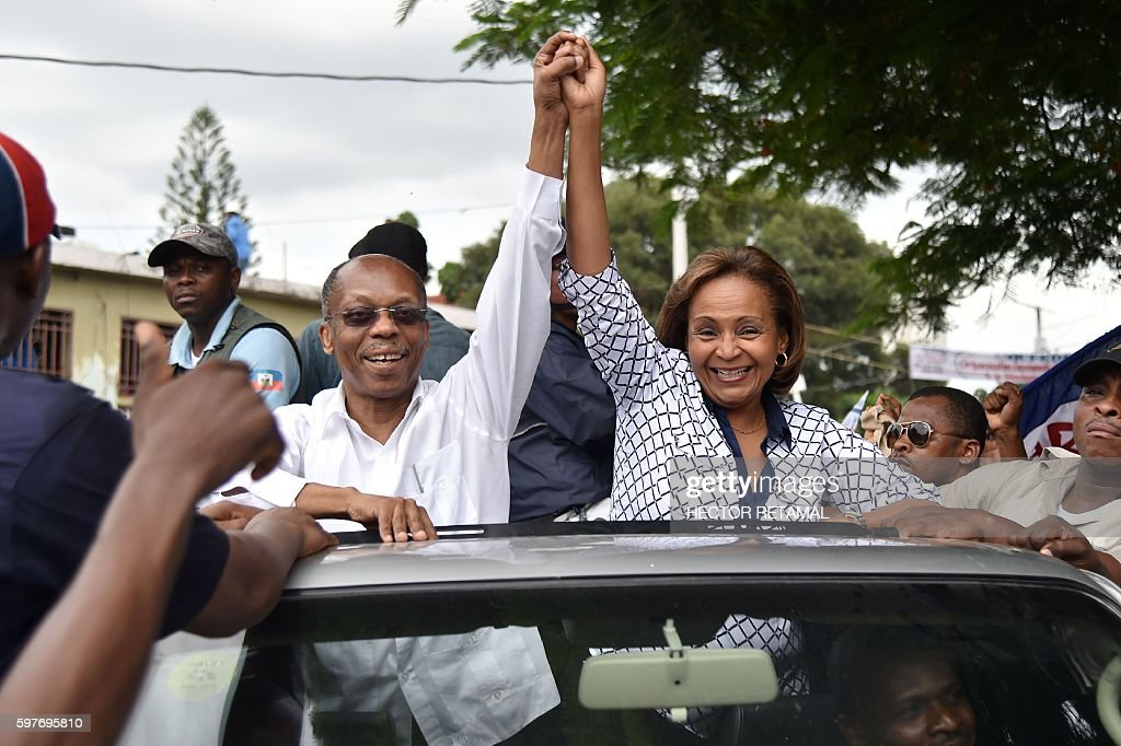 Presidential Candidate from Lavalas Political Party Marysse Narcisse with former President Jean Bertrand Aristide greet their supporters during a...