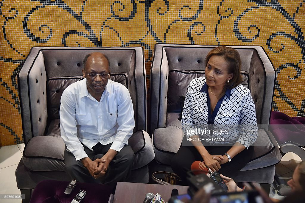 Presidential Candidate from Lavalas Political Party Marysse Narcisse with former President Jean Bertrand Aristide giving a press conference in...